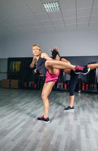 Women training kick boxing in the gym