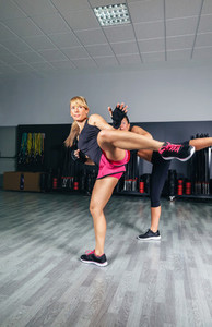 Women training kick boxing in the gym