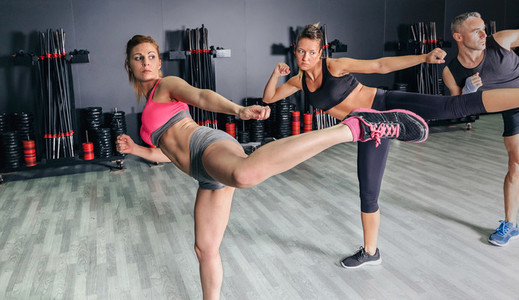 People in a boxing class training high kick