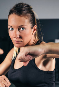 Woman training hard boxing in the gym