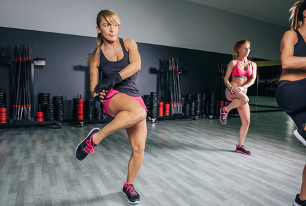 Women training boxing in a fitness center