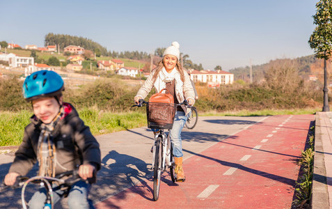 Family with child riding bicycles in the nature