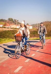 Couple riding bicycles in the nature