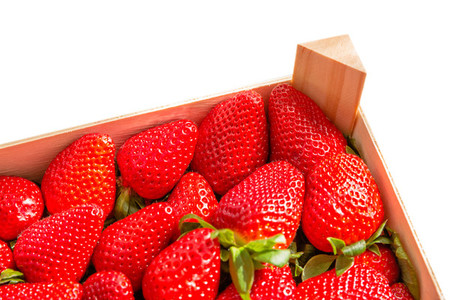 Box corner of strawberries isolated on white background