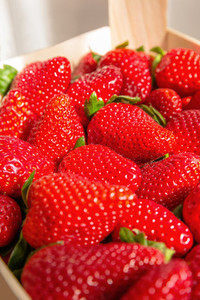 Closeup of freshly strawberries in a wooden box