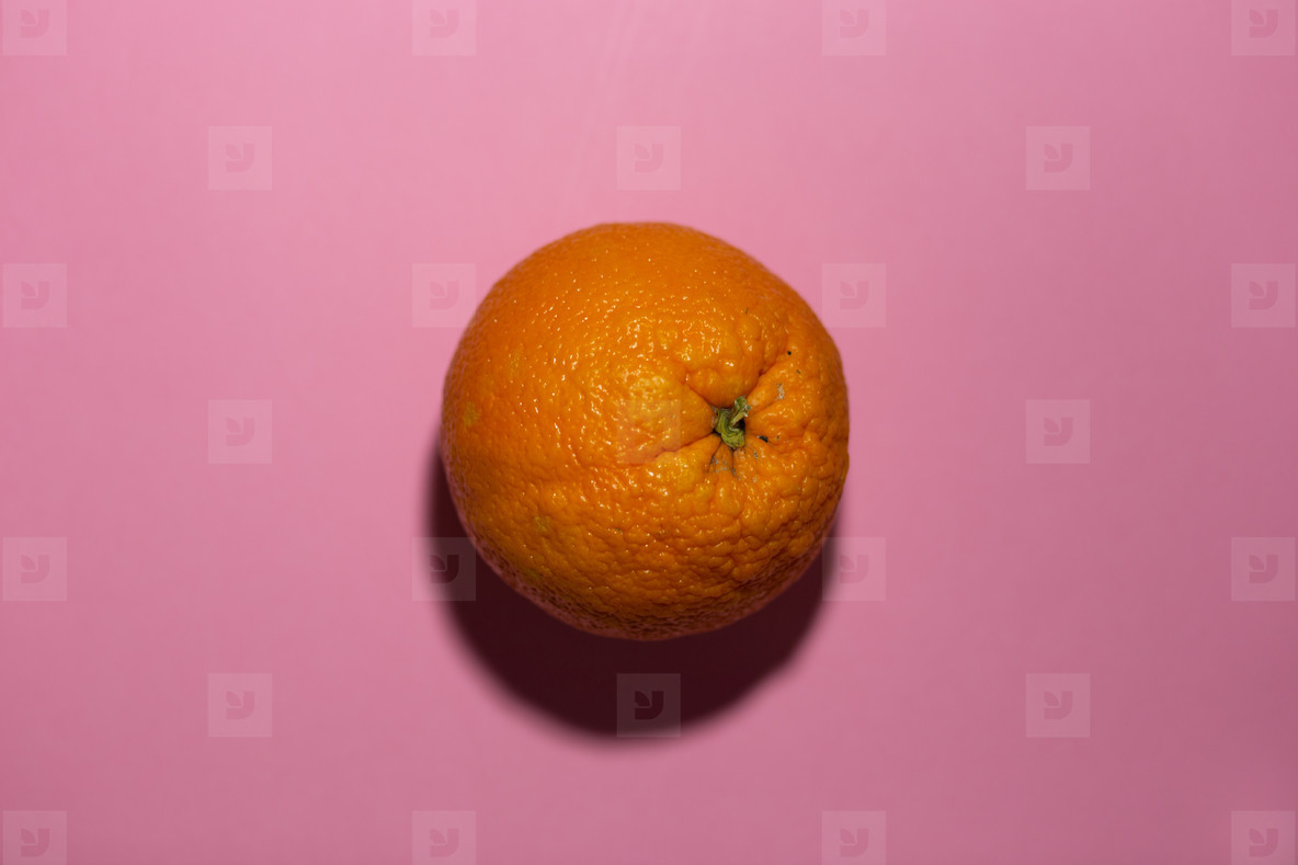 orange on a pink colored backgro
