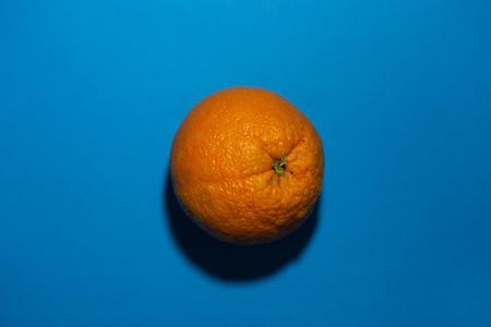 orange on a blue colored backgro