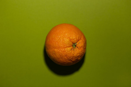 orange on a green colored backgr