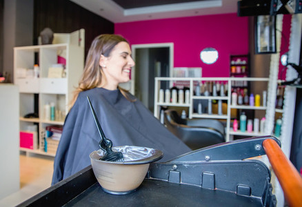 Hair dye in bowl and brush for hair treatment