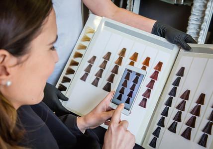 Woman taking a photo to the hair dye palette