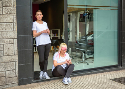 Hairdressers women in a coffee break time