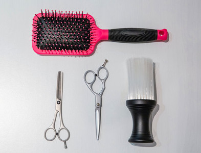 Hairdressing equipment over a white wooden background