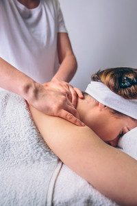 Woman receiving relaxing back massage on clinical center