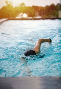 Young girl swimming freestyle
