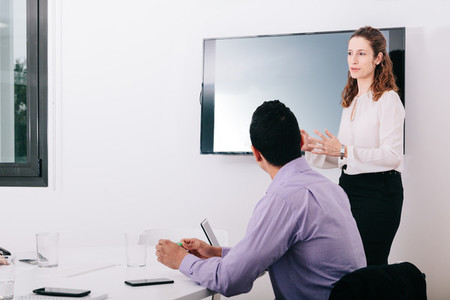 Businesswoman talking in front of her colleagues in the office