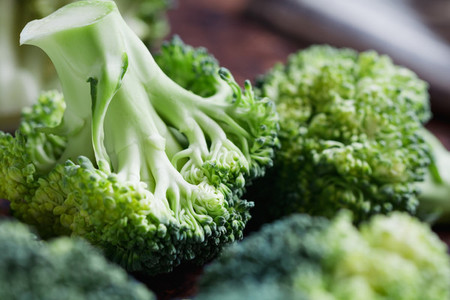 Close up of a fresh broccoli on a cutting board  The concept of vegetarian and healthy food