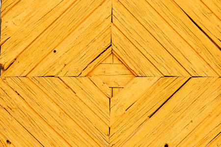 Yellow wooden background Rhombus pattern details on a door