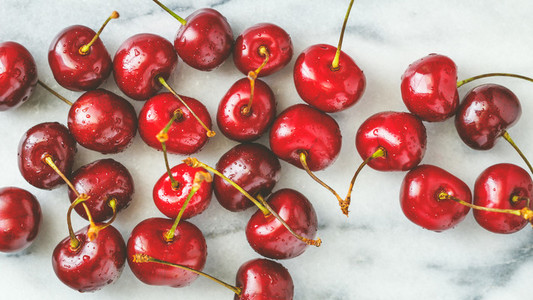 Ripe cherry on a white marble  The concept of healthy organic food