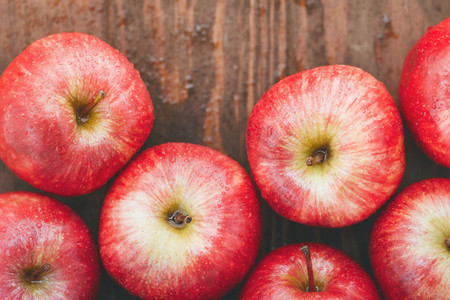 Harvest of ripe apples variety Red Delicious Food background top view flat lay