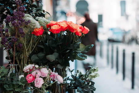 View of a bouquet of scarlet roses in a street flower shop in Paris  France