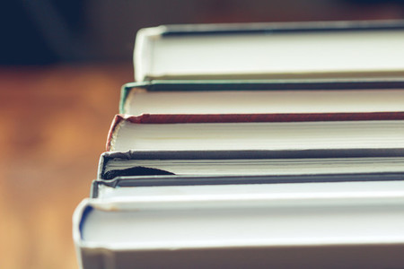 Stack of books on the table View from above Selective focus