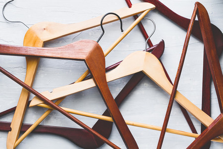 Wooden hangers over white table Abstract composition