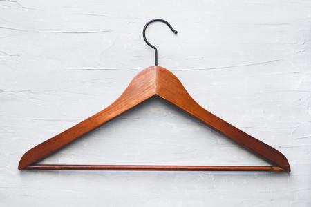 Single wooden hanger over white table
