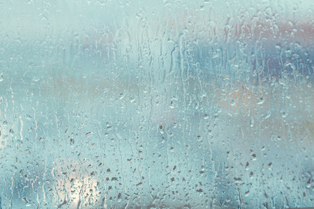 Raindrops on a window in evening  Refocused background