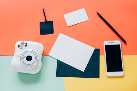 Creative flat lay style of workspace desk with instant camera  s
