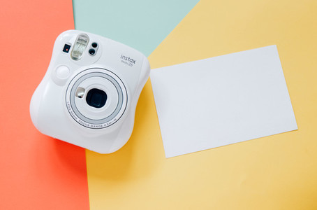 Instant camera with blank paper