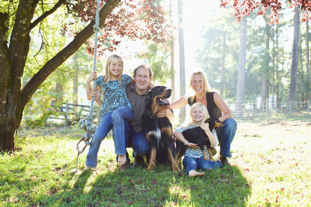 Portrait happy family with dogs