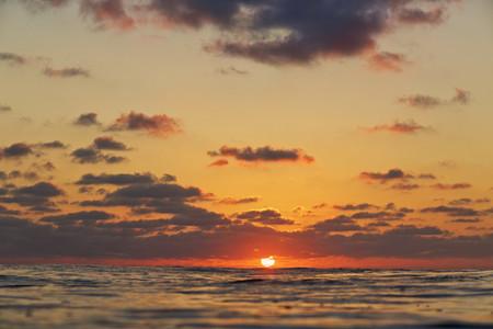 Tranquil sunset over ocean horizon