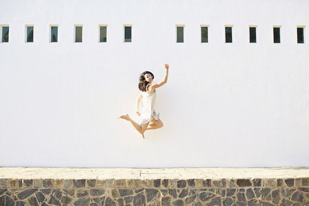 Portrait happy carefree woman jumping