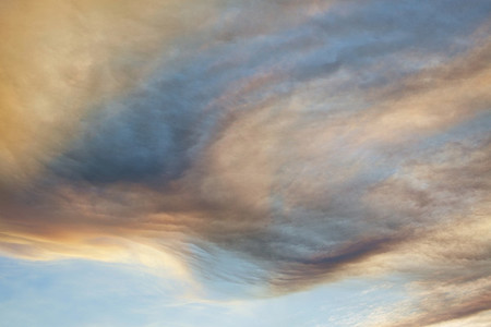 Clouds forming swirling pattern in dramatic sky