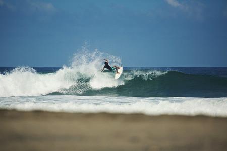 Male surfer riding ocean wave