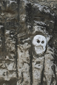 Skeleton face carved into rock