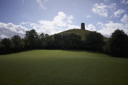 Idyllic view Glastonbury Tor on rural hilltop England