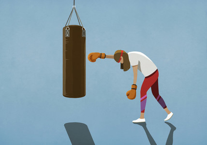 Tired woman boxing at punching bag
