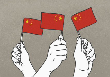 Hands waving small Chinese flags