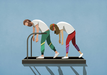 Tired couple walking on treadmill