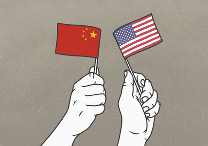 Hands waving small American and Chinese flags