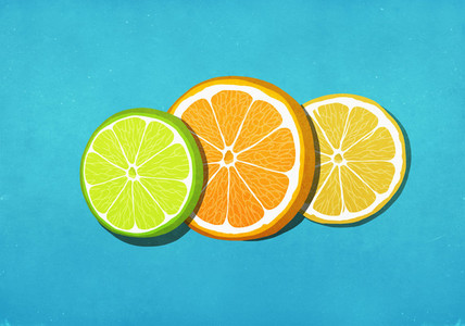 Fresh  vibrant lime  orange and lemon slices on blue background
