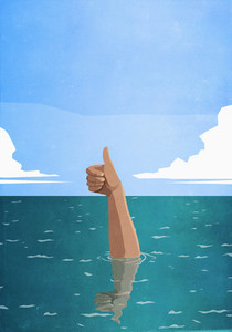 Sinking hand gesturing thumbs up in sea