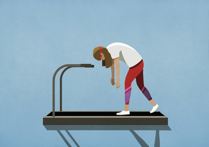 Tired woman walking on treadmill