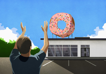 Man with arms raised looking up at pink donut on top of bakery