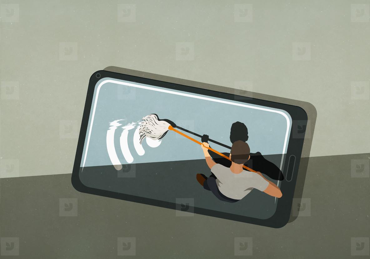 Man mopping wifi symbol on smart phone screen