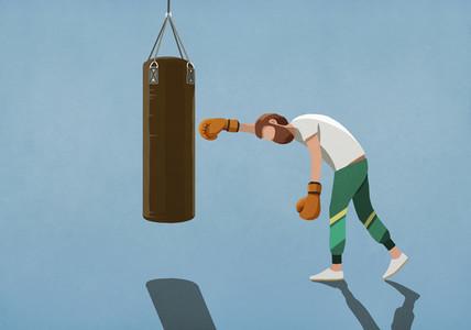 Tired man boxing at punching bag