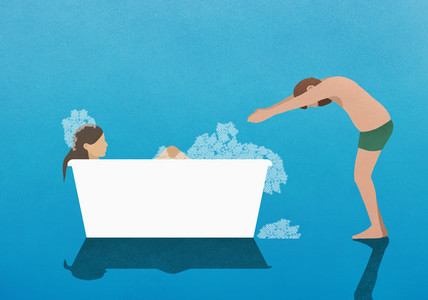 Husband preparing to dive into bubble bath with wife