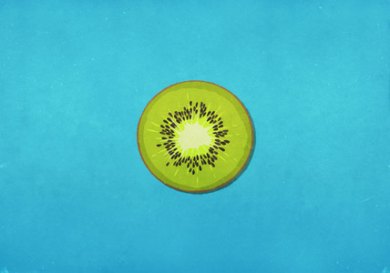 Fresh green kiwi slice on blue background