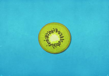 Fresh green kiwi slice on blue background